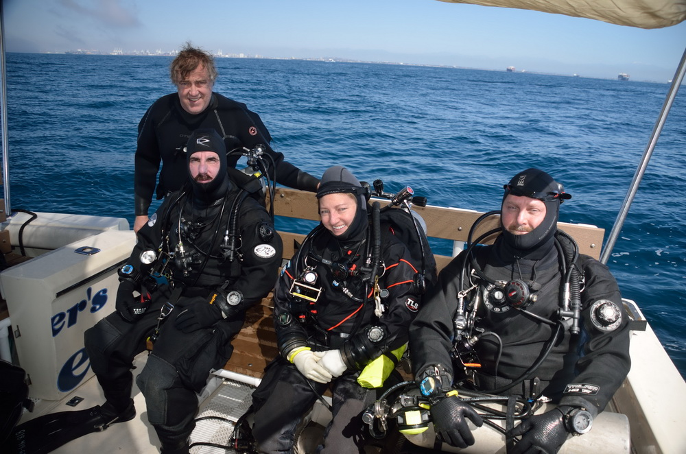 Kim with other divers ready to go retrieve manmade debris