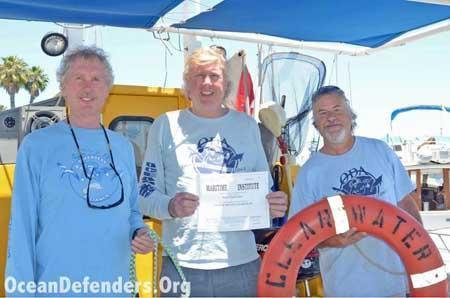 "Onboard the <em>Clearwater</em> in dock: Jim Lieber, Kurt Lieber, and Jeff Connor celebrate Kurt's new ""Master 100 Tons"" captain's license."
