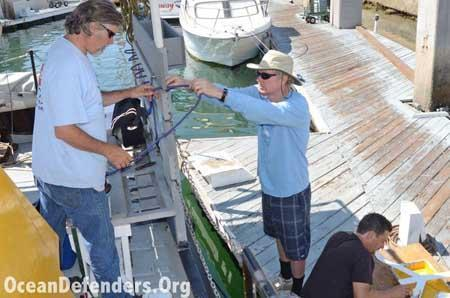 Onboard the <em>Clearwater</em> in dock: Jeff Connor, Jim Lieber, and Billy Arcila working on the boat.