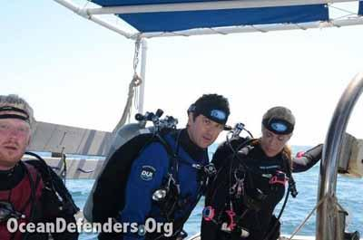 David Watson, Rick Guerin and Lori Thanos gear up for a dive.