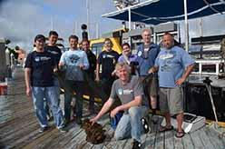 ODA Dive & Boat Crew with net at slip - left to right: Shingo Ishida, Andy The, Eric Humphreys, Steve Millington, Jeff Connor, Lyndsey, Jim Lieber, Mike Jessen, and in front Kurt Lieber.