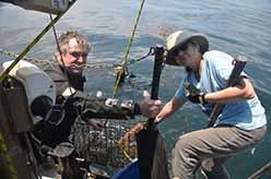 ODA volunteer crew Al Laubenstein and Lisa Davis hauling trap (Kurt Leiber in water)