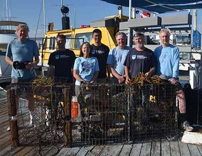 Oda Volunteer Boat & Dive Crew at dock with recovered traps