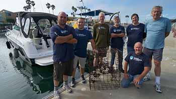 ODA Dive & Boat Crew at dock wit reclaimed lobster trap