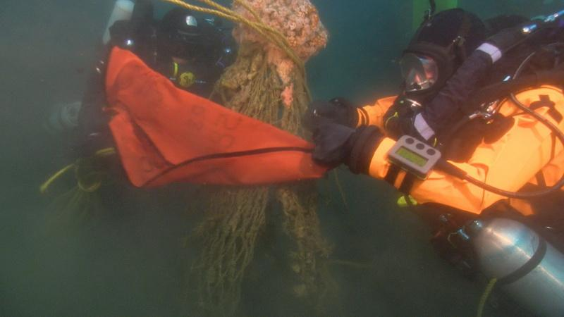 Float bag being attached to ghost net