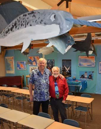 Kurt Lieber and teacher Tim Pearson celebrate the ocean conservation education of the kids!