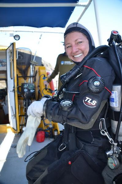 ODA Volunteer Diver Kim Cardenas suiting-up on the deck of our conservation vessel