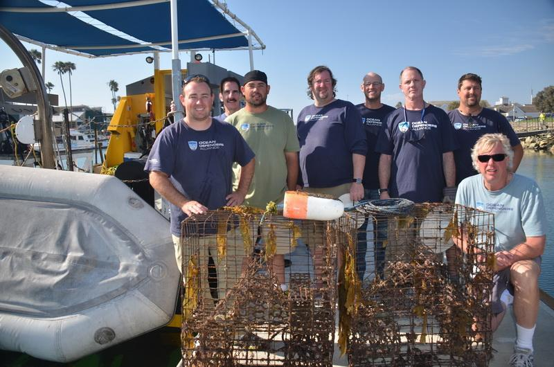ODA Volunteer Dive & Boat Crew display the abandoned lobster traps removed from the sea.