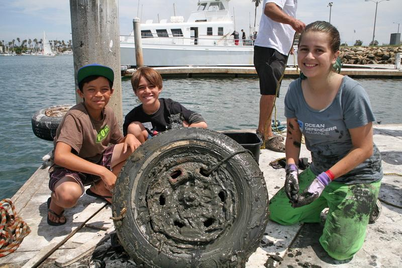 Ocean Defenders team with recovered icean debris - a tire