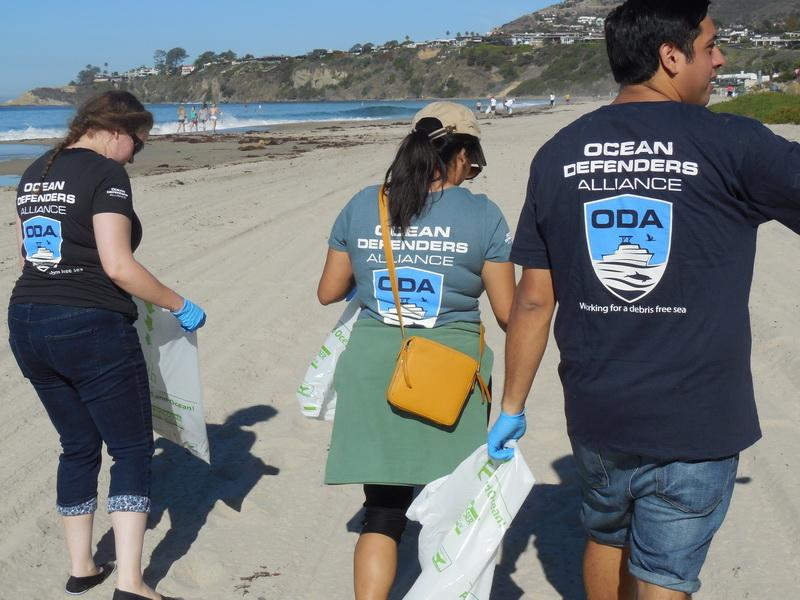 Disney and Ocean Defenders Alliance clean the Orange County Beach together