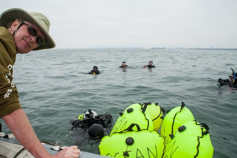 ODA volunteer divers in water with Rigid Inflatable Boat (RIB) and lift bags