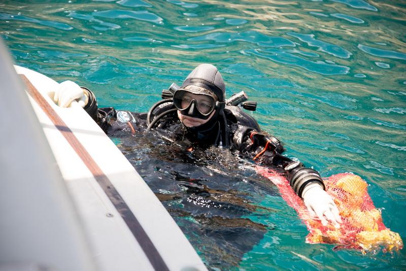 ODA Volunteer Diver Kim Cardenas in the water, ready to submerge