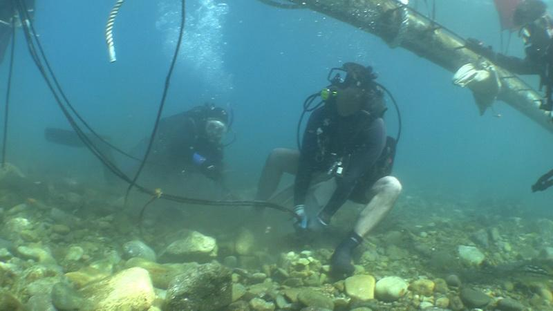 ODA Dive volunteer Jason Manix tugging on cable of sunken wreck Godspeed