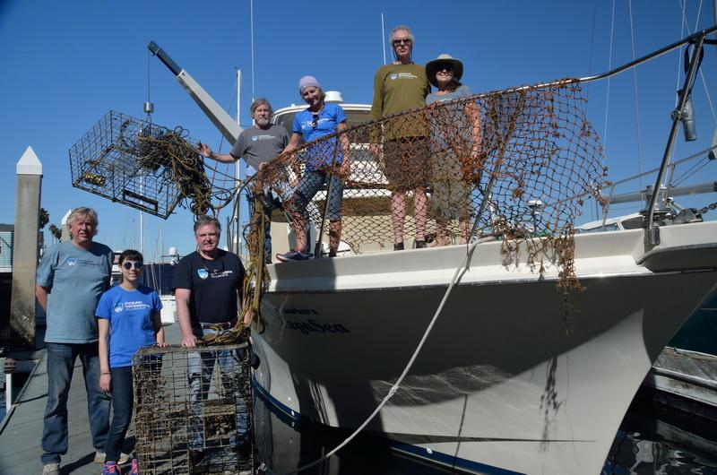 A happy crew with hauled-out marine debris