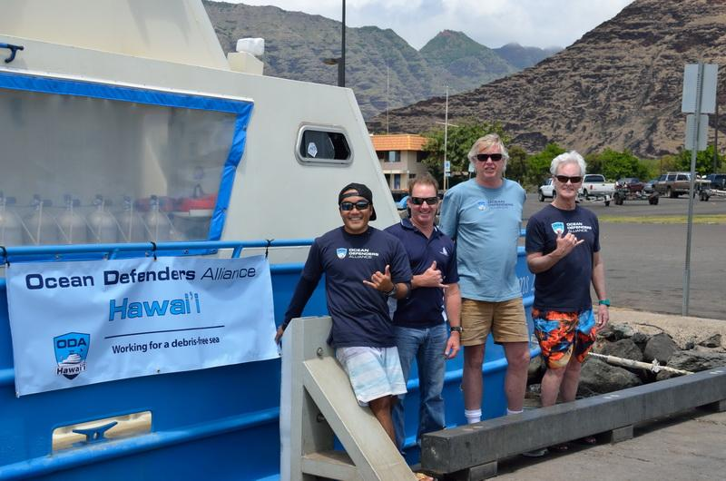 Mash Hatae, Doug Ewalt, Kurt Lieber, and Steve Boreman in front of the vessel Sea Dreams.t 1LR