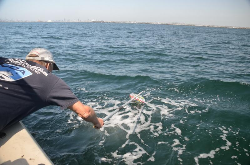 Ocean Defender volunteer Dave Merrill cleans the ocean of pollution