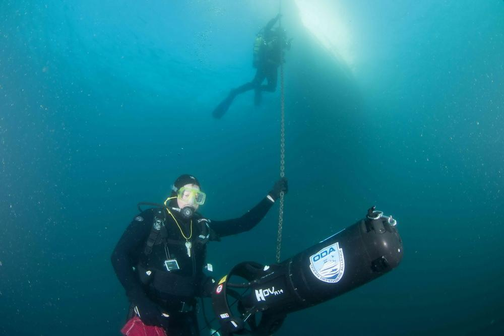 ODA Dive Team member Jim McKeeman with scooter on chain