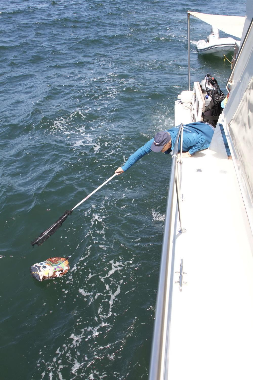 Ocean Defenders removing Mylar balloon debris from the sea