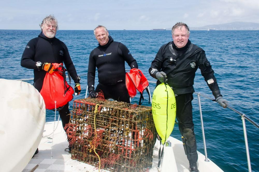 Ocean heroes Jeff, Bob, and Al with trap they removed