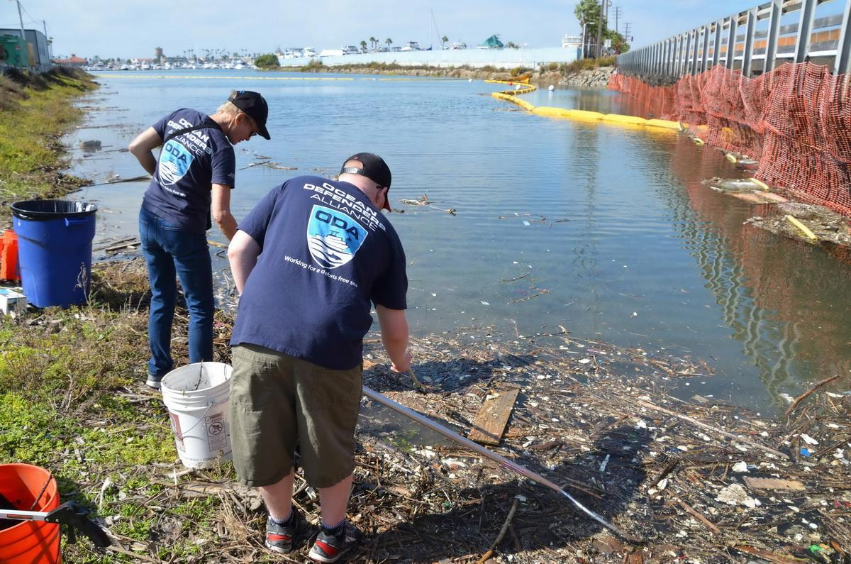 ODA Volunteers Linda and Dylan cleaning the water channel