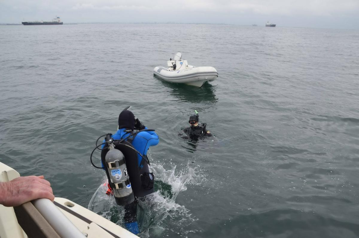 Dive crew retrieve debris