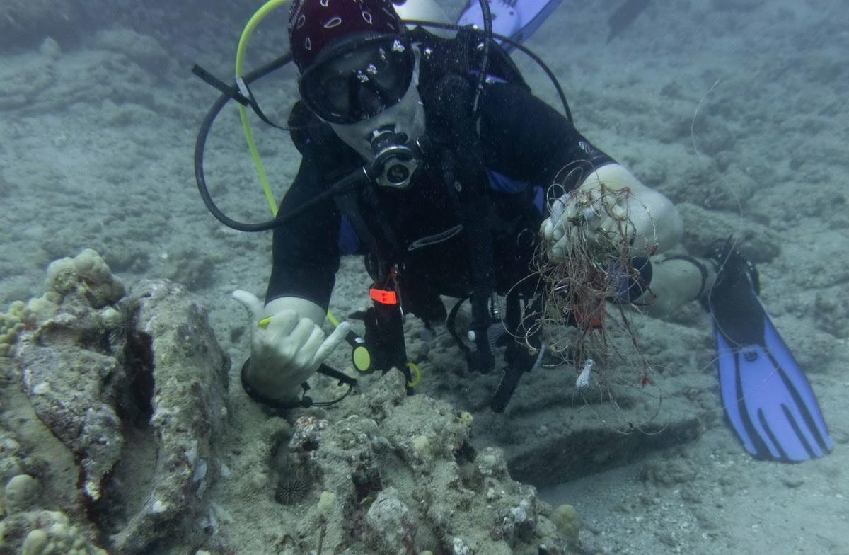 ODA SCUBA Diver removes fishing line