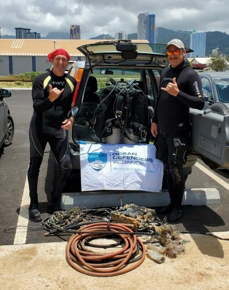 ODA Divers Glenn and Ed display the abandoned gear they removed